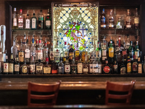 Beautiful bar with a wall of adult beverages.