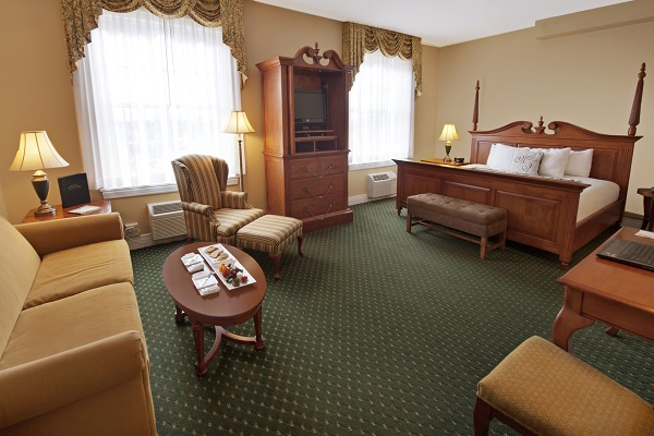 historic accessible room with lounge area and bed