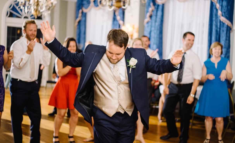 groom dancing at his wedding reception