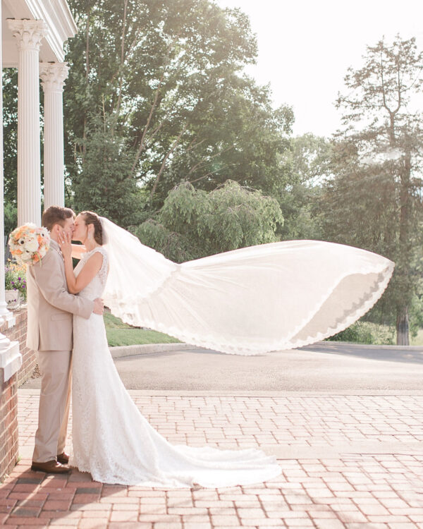 bride and groom on red brick at mimslyn entrance