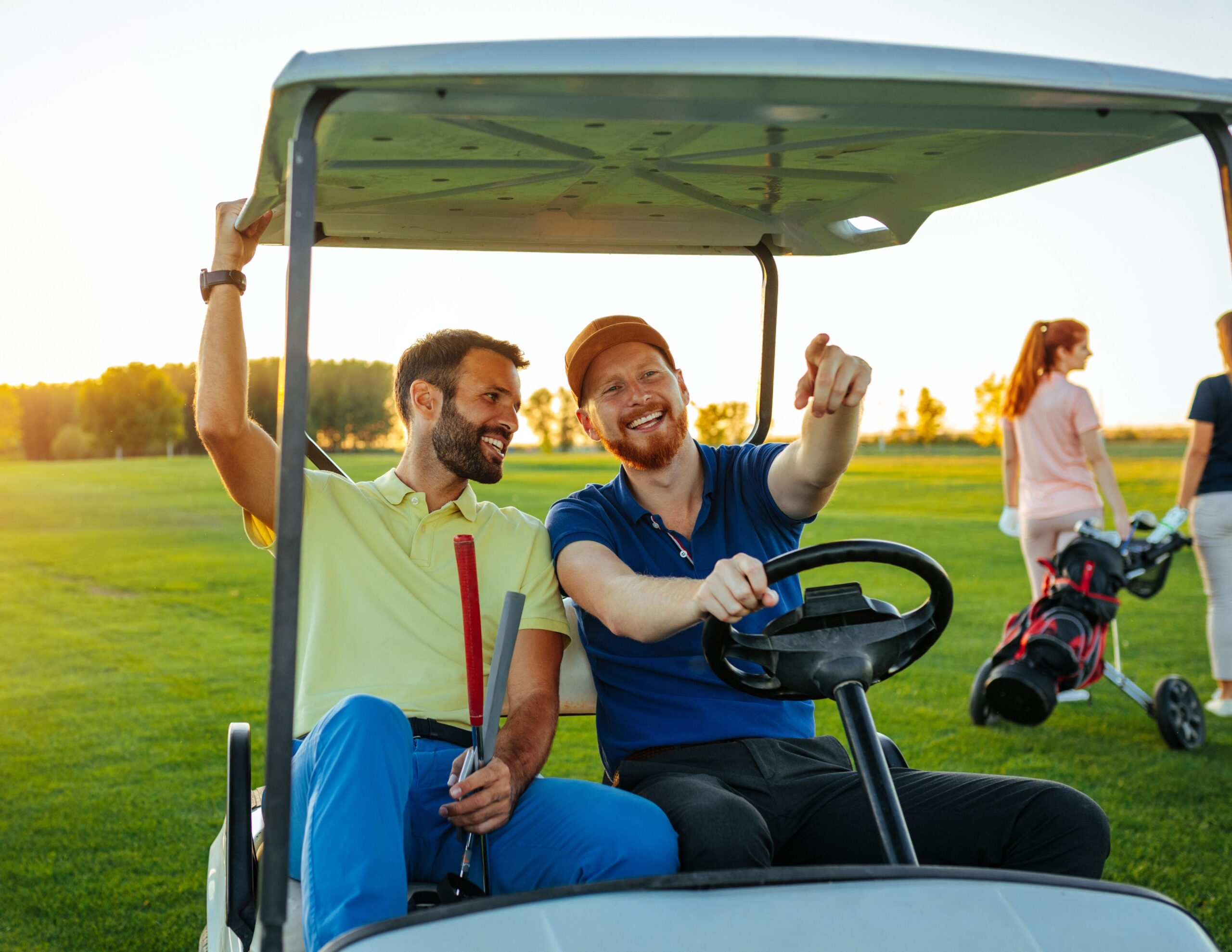 two men in a golf cart